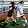 Broomfield's Kerri Marquardt keeps the ball ahead of  Mountain View's MaKenzie Ross during Friday's game at Elizabeth Kennedy Stadium.<br /> March 23, 2012 <br /> staff photo/ David R. Jennings