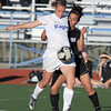 Broomfield's Katie Forsee keeps the ball from Mountain View's Paulina  Barraza during Friday's game at Elizabeth Kennedy Stadium.<br /> March 23, 2012 <br /> staff photo/ David R. Jennings