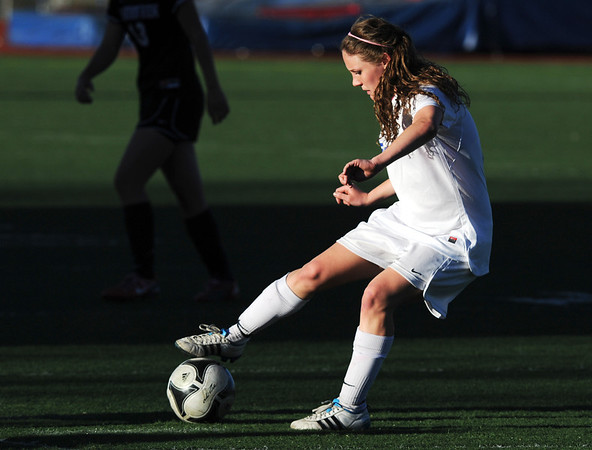 Broomfield's Lauren Snyder moves the ball down field against Mountain View during Friday's game at Elizabeth Kennedy Stadium.<br /> March 23, 2012 <br /> staff photo/ David R. Jennings