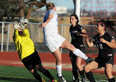 Mountain View's goalie Shilee Calhoun blocks a shot by Broomfield's Katie Forsee during Friday's game at Elizabeth Kennedy Stadium. March 23, 2012  staff photo/ David R. Jennings