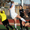 Mountain View's goalie Shilee Calhoun blocks a shot by Broomfield's Katie Forsee during Friday's game at Elizabeth Kennedy Stadium.<br /> March 23, 2012 <br /> staff photo/ David R. Jennings