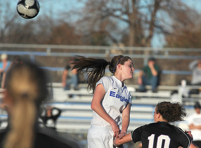 Broomfield's Elle Milner does a header past Mountain View during Friday's game at Elizabeth Kennedy Stadium. March 23, 2012  staff photo/ David R. Jennings