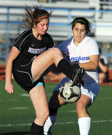 Broomfield's Kerri Marquadt and  Mountain View's Hallie Stolte fight for possession of the ball during Friday's game at Elizabeth Kennedy Stadium.<br /> March 23, 2012 <br /> staff photo/ David R. Jennings