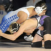 """Broomfield's Dylan Alvarezwrestles Mountain View's Randy MacDonald in the 113 lb. weight class during Thursday's match at Broomfield.<br /> For more photos please see  <a href=""""http://www.broomfieldenterprise.com"""">http://www.broomfieldenterprise.com</a>.<br /> January 12, 2012<br /> staff photo/ David R. Jennings"""