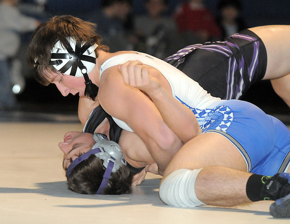 """Broomfield's Luke McAninch wrestles Mountain View's Lowell Knapp in the 160 lb. weight class during Thursday's match at Broomfield.<br /> For more photos please see  <a href=""""http://www.broomfieldenterprise.com"""">http://www.broomfieldenterprise.com</a>.<br /> January 12, 2012<br /> staff photo/ David R. Jennings"""