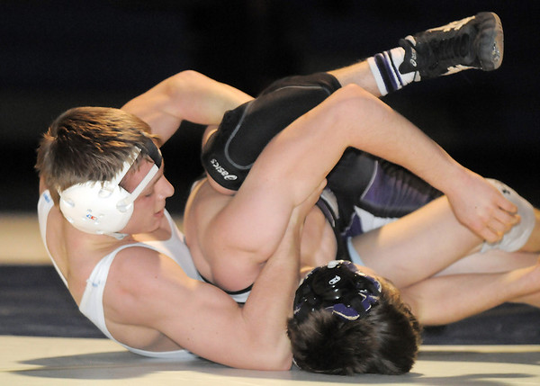 """Broomfield's Jonathon Stelling wrestles Mountain View's Austin Dunbar in the 126 lb. weight class during Thursday's match at Broomfield.<br /> For more photos please see  <a href=""""http://www.broomfieldenterprise.com"""">http://www.broomfieldenterprise.com</a>.<br /> January 12, 2012<br /> staff photo/ David R. Jennings"""