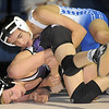 "Broomfield's Dylan Alvarezwrestles Mountain View's Randy MacDonald in the 113 lb. weight class during Thursday's match at Broomfield.<br /> For more photos please see  <a href=""http://www.broomfieldenterprise.com"">http://www.broomfieldenterprise.com</a>.<br /> January 12, 2012<br /> staff photo/ David R. Jennings"