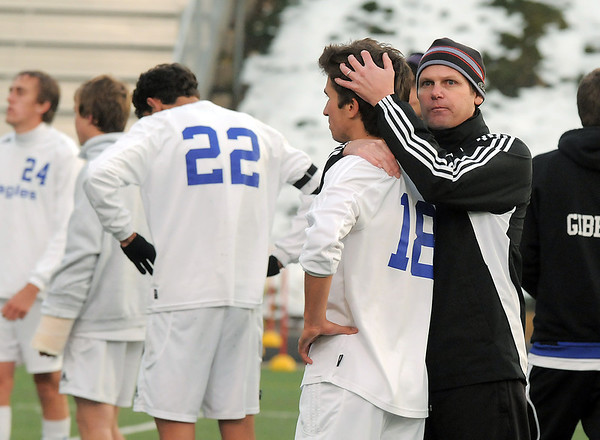 Broomfield coach Jim Davidson, right, comforts Ross Donaldson after loosing to Mullen in the state 4A semi final game at Englewood High School.<br /> <br /> November 5, 2011<br /> staff photo/ David R. Jennings