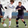 Fernando Cabrera, Broomfield, dribbles the ball downfield against Collin Stein, Mullen, during the state 4A semi final game at Englewood High School.<br /> <br /> November 5, 2011<br /> staff photo/ David R. Jennings