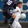 Fernando Cabrera, Broomfield, advances the ball downfield against  Cameron Taylor, Mullen, during the state 4A semi final game at Englewood High School.<br /> <br /> November 5, 2011<br /> staff photo/ David R. Jennings