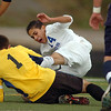 Ricardo Ocampo, Broomfield, collides with goalie Liam O'Connor, Mullen, during the state 4A semi final game at Englewood High School.<br /> <br /> November 5, 2011<br /> staff photo/ David R. Jennings