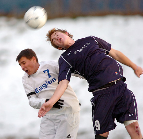 Nick Saunders, Broomfield, goes up for a header against Skyler Erickson, Mullen, during the state 4A semi final game at Englewood High School.<br /> <br /> November 5, 2011<br /> staff photo/ David R. Jennings