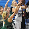 Broomfield's Bre Burgesser works her way to the basket against Niwot 's Callie Hammers during Friday's game at Broomfield.<br /> <br /> <br /> January 29, 2010<br /> Staff photo/David R. Jennings