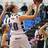 Meagan Prins, Broomfield, goes to the basket against Niwot during Friday's game at Broomfield.<br /> <br /> <br /> January 29, 2010<br /> Staff photo/David R. Jennings