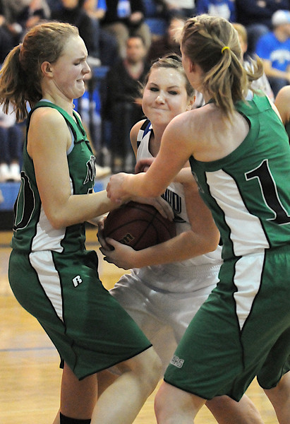 Broomfield's Millie Reeves, fights for the ball with Niwot's Kelly Piletic, left, and Janae Larson during Friday's game at Broomfield.<br /> <br /> <br /> January 29, 2010<br /> Staff photo/David R. Jennings