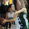 Millie Reeves, Broomfield, looks for an open teammate past Janae Larson, Niwot, during Friday's game at Broomfield.<br /> <br /> <br /> January 29, 2010<br /> Staff photo/David R. Jennings