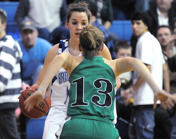 Katie Nehf, Broomfield, prepares to go around Ashley Philipp, Niwot , during Friday's game at Broomfield.<br /> <br /> <br /> January 29, 2010<br /> Staff photo/David R. Jennings