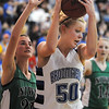 Bre Burgesser, Broomfield, rebound the ball away from Amy Keschl, Niwot , during Friday's game at Broomfield.<br /> <br /> <br /> January 29, 2010<br /> Staff photo/David R. Jennings