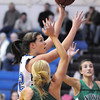 Renae Waters, Broomfield, goes to the basket past Callie Hammers, Niwot, during Friday's game at Broomfield.<br /> <br /> <br /> January 29, 2010<br /> Staff photo/David R. Jennings