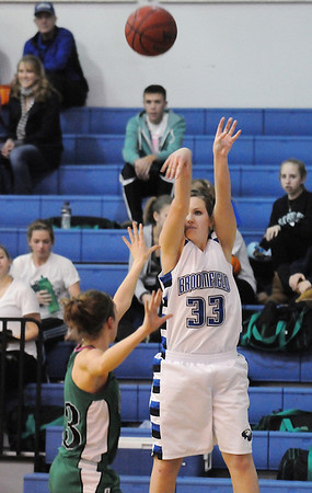 Millie Reeves,  Broomfield, shoots to the basket past Ashley Philipp, Niwot, during Friday's game at Broomfield.<br /> <br /> <br /> January 29, 2010<br /> Staff photo/David R. Jennings