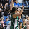 Renae Waters, Broomfield, goes to the basket past Amy Keschl, Niwot , during Friday's game at Broomfield.<br /> <br /> <br /> January 29, 2010<br /> Staff photo/David R. Jennings