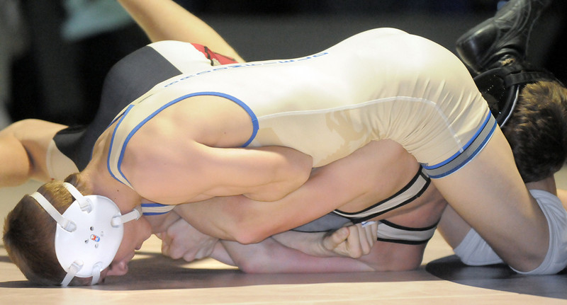 Broomfield's Johnathan Stelling wrestles Ponderosa's J. T. Mason in the 112 lb. weight class during the dual meet ain the Kim Wilkerson Gym.<br /> <br /> January 12, 2011<br /> staff photo/David R. Jennings