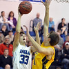 Broomfield's Brandon Hull shoots the ball past against Pueblo East's Ryan Armijo during Saturday's game at Broomfield.<br /> <br /> February 2, 2013<br /> staff photo/ David R. Jennings