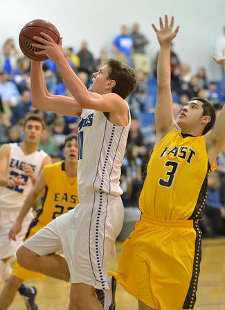 Broomfield's Spenser Reeb goes to the basket past Pueblo East's Alex Jara during Saturday's game at Broomfield.<br /> <br /> February 2, 2013<br /> staff photo/ David R. Jennings