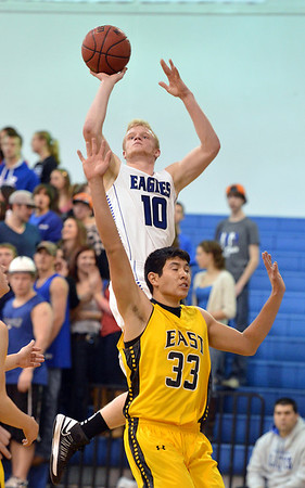 Broomfield's Dan Perse shoots to the basket over  Pueblo East's Jimmy Valdez during Saturday's game at Broomfield.<br /> <br /> February 2, 2013<br /> staff photo/ David R. Jennings