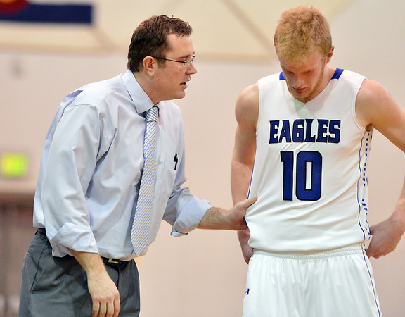 Broomfield's head coach Terrence Dunn talks to Dan Perse during the game against Pueblo East on Saturday at Broomfield.<br /> <br /> February 2, 2013<br /> staff photo/ David R. Jennings