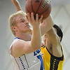 Broomfield's Dan Perse goes to the basket against Pueblo East's Ryan Armijo during Saturday's game at Broomfield.<br /> <br /> February 2, 2013<br /> staff photo/ David R. Jennings