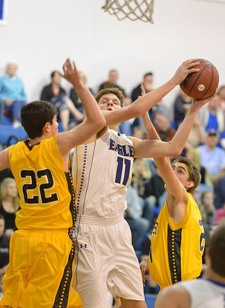 Broomfield's Spenser Reeb goes to the basket against Pueblo East's Ty Gavin and John Paul Eggert during Saturday's game at Broomfield.<br /> <br /> February 2, 2013<br /> staff photo/ David R. Jennings