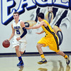 Broomfield's Evan Kihn dribbles the ball downcourt against Pueblo East's Ty Gavin during Saturday's game at Broomfield.<br /> <br /> February 2, 2013<br /> staff photo/ David R. Jennings