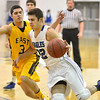 Broomfield's Alec McLain dribbles the ball around  Pueblo East's Alex Jara during Saturday's game at Broomfield.<br /> <br /> February 2, 2013<br /> staff photo/ David R. Jennings