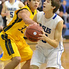 Broomfield's Brandon Hull goes to the basket against Pueblo East's Jimmy Valdez during Saturday's game at Broomfield.<br /> <br /> February 2, 2013<br /> staff photo/ David R. Jennings