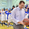 Broomfield High's  head coach Terrence Dunn looks at the basketball signed by his team in honor of Dunn's 100th win before the game against Pueblo East on Saturday.<br /> February 2, 2013<br /> staff photo/ David R. Jennings