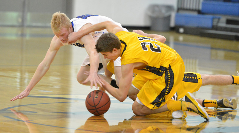 Broomfield's Dan Perse scrambles for a loose ball against Pueblo East's John Paul Eggert during Saturday's game at Broomfield.<br /> <br /> February 2, 2013<br /> staff photo/ David R. Jennings