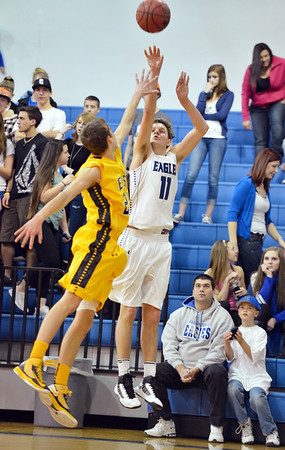 Broomfield's Spenser Reeb shoots the ball over  Pueblo East's John Paul Eggert during Saturday's game at Broomfield.<br /> <br /> February 2, 2013<br /> staff photo/ David R. Jennings