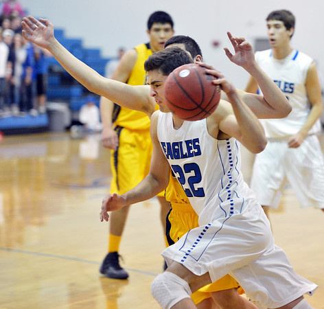 Broomfield's Alec McLain dribbles the ball around  Pueblo East's Alex Jara during Saturday's game at Broomfield.<br /> <br /> <br /> February 2, 2013<br /> staff photo/ David R. Jennings