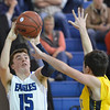 Broomfield's Evan Kihn shoots the ball over  Pueblo East's Ty Gavin during Saturday's game at Broomfield.<br /> <br /> February 2, 2013<br /> staff photo/ David R. Jennings