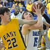Broomfield's Evan Kihn goes to the basket against Pueblo East's Ty Gavin during Saturday's game at Broomfield.<br /> <br /> February 2, 2013<br /> staff photo/ David R. Jennings