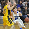 Broomfield's Evan Kihn dribbles to the basket against Pueblo East's Derek Gutierrez during Saturday's game at Broomfield.<br /> <br /> February 2, 2013<br /> staff photo/ David R. Jennings