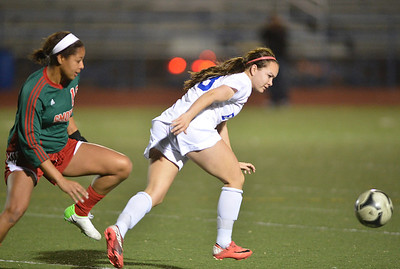 Kayla Snyder, Broomfield controls the ball past Candace Cephers, Smoky Hill during Thursday's game at Elizabeth Kennedy Stadium. March 7, 2013 staff photo/ David R. Jennings