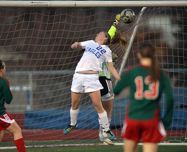 Katie Forsee, Broomfield nearly gets the ball past Megan Kneefel,  goalie Smoky Hill during Thursday's game at Elizabeth Kennedy Stadium. March 7, 2013 staff photo/ David R. Jennings