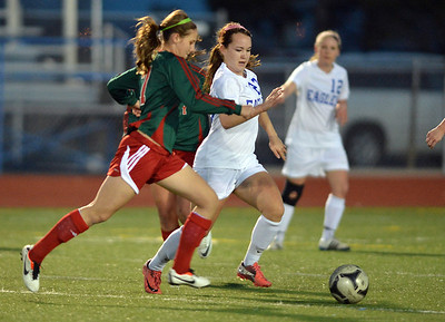 Katie Forsee, Broomfield defends the ball against Madi Watts, Smoky Hill during Thursday's game at Elizabeth Kennedy Stadium. March 7, 2013 staff photo/ David R. Jennings