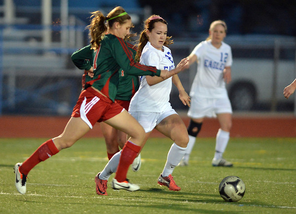 Katie Forsee, Broomfield defends the ball against Madi Watts, Smoky Hill during Thursday's game at Elizabeth Kennedy Stadium.<br /> March 7, 2013<br /> staff photo/ David R. Jennings