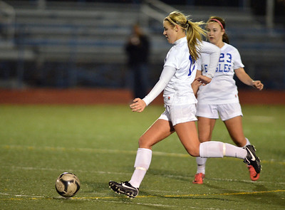 Hailey Mazzola, left, and Kayla Snyder, Broomfield move the ball downfield against Smoky Hill during Thursday's game at Elizabeth Kennedy Stadium. March 7, 2013 staff photo/ David R. Jennings