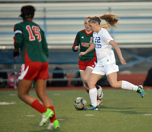 Katie Forsee, Broomfield moves the ball down field past Candace Cephers and Leah Stoffel, Smoky Hill during Thursday's game at Elizabeth Kennedy Stadium.<br /> March 7, 2013<br /> staff photo/ David R. Jennings