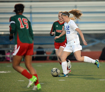 Katie Forsee, Broomfield moves the ball down field past Candace Cephers and Leah Stoffel, Smoky Hill during Thursday's game at Elizabeth Kennedy Stadium. March 7, 2013 staff photo/ David R. Jennings