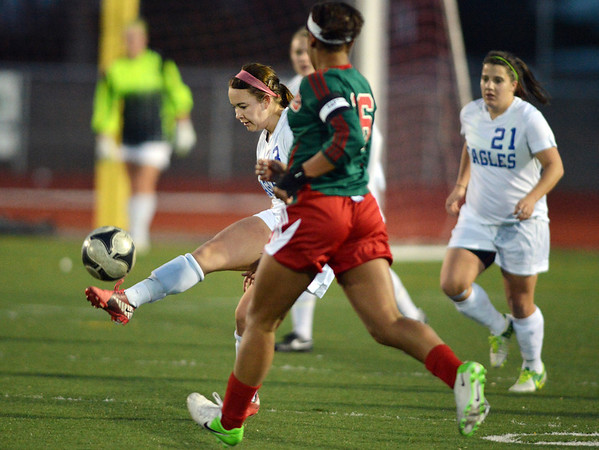 Kayla Snyder, Broomfield kicks the ball past Candace Cephers, Smoky Hill during Thursday's game at Elizabeth Kennedy Stadium.<br /> March 7, 2013<br /> staff photo/ David R. Jennings